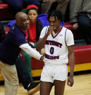 Detroit Mercy's Antoine Davis is congratulated by a fan, after breaking Stephen Curry's NCAA record for 3-pointers by a freshman in a win over IUPUI, Thursday, Feb. 28, 2019, in Detroit.