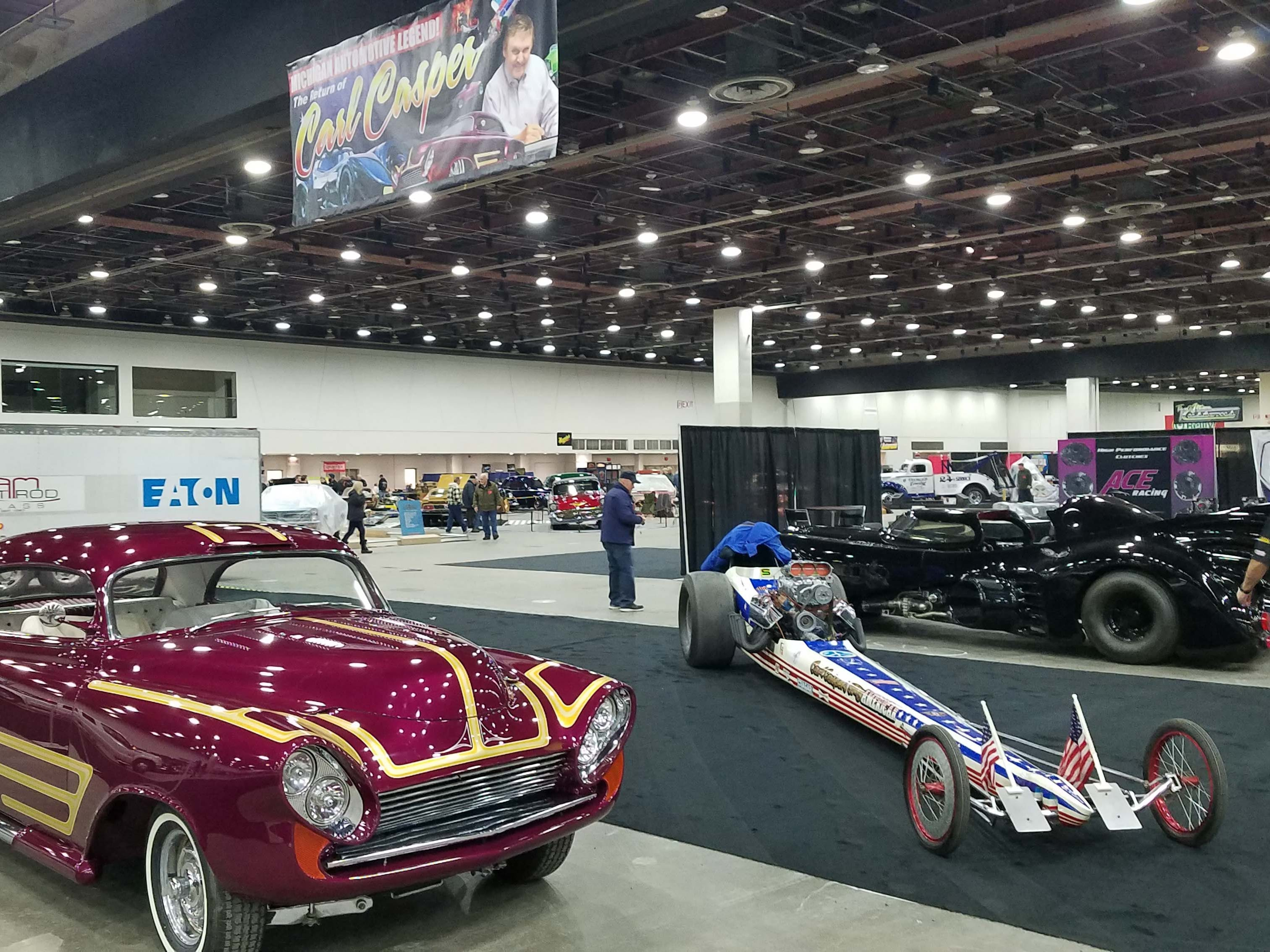 "Carl Caspar's stable at Autorama shows off (l to r) a '61 best-in-show winner, slingshot dragster, and Batmobile from ""Batman Returns."""