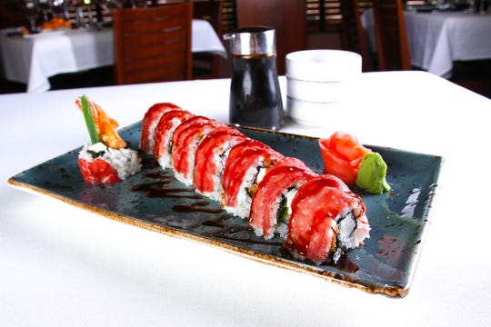 The Somerset roll at Ocean Prime is made with tempura shrimp, cream cheese, scallion and topped with beef carpaccio.