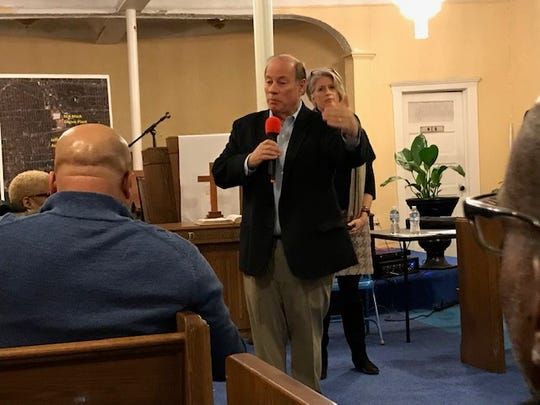 Detroit Mayor Mike Duggan fielded questions from residents affected by the Fiat Chrysler plans Thursday at Siloam Missionary Baptist Church on the east side.