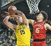Nebraska's Isaiah Roby, right, defends a shot by Michigan center Jon Teske (15) in the first half. Teske finished with a career-high 22 points as the Wolverines defeated the Cornhuskers, 82-53, Thursday.