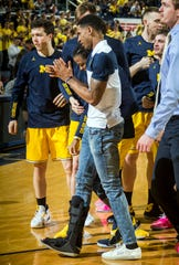 Charles Matthews wears a walking boot during Michigan's game against Nebraska on Thursday night.