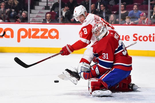 Canadiens goalie Carey Price, right, makes a save on Red Wings forward Justin Abdelkader at the Bell Centre in Montreal last year.