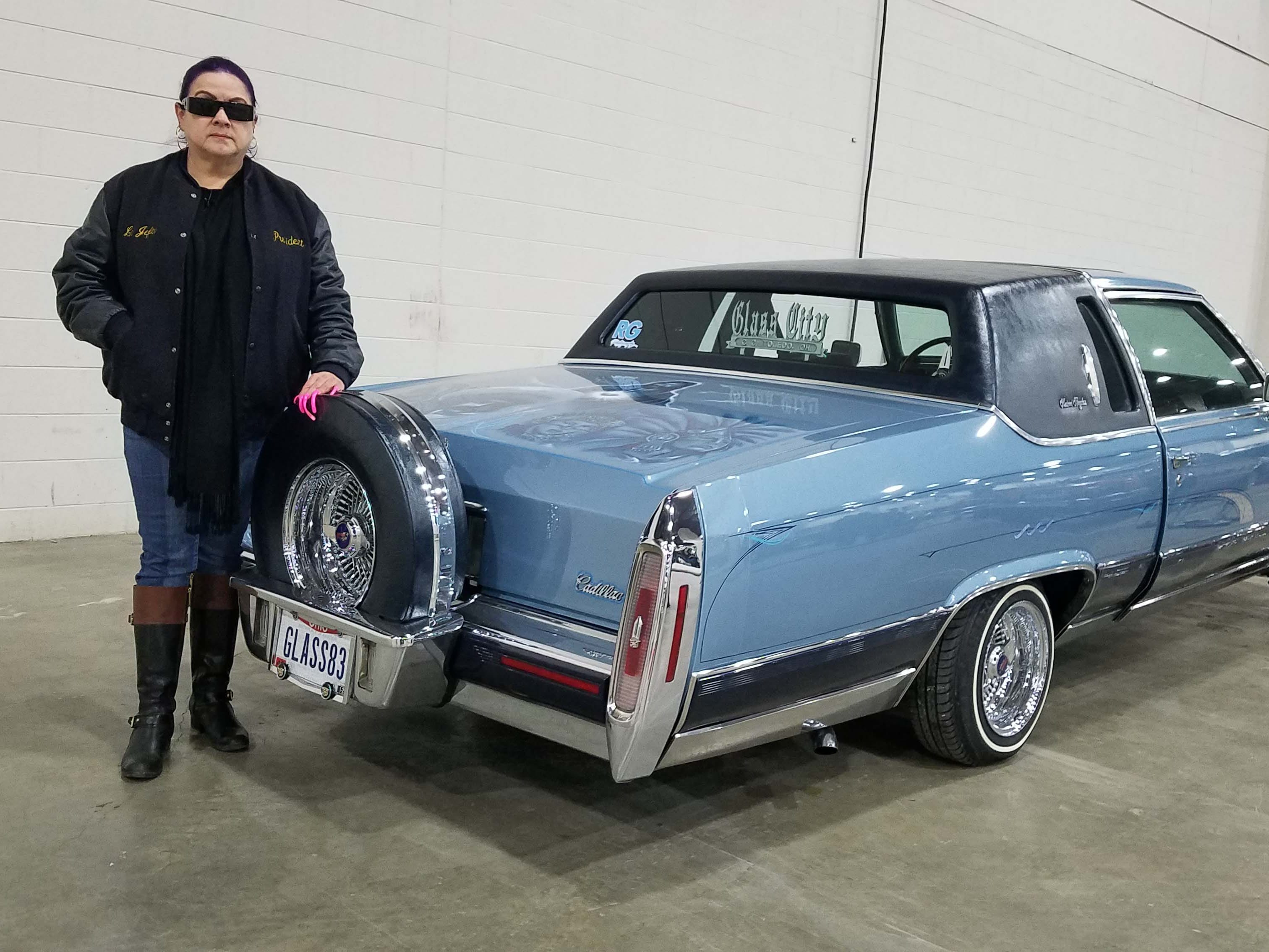 "The ""Queen of the Lowriders,"" Debbie Sanchez of Detroit brought together 14 low-riders for Autorama this year."