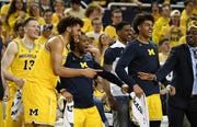 From left, Michigan forward Ignas Brazdeikis (13), Michigan forward Isaiah Livers, Zavier Simpson (3) and Jordan Poole (2) react after Michigan forward Colin Castleton, not shown, is fouled on a basket in the second half.