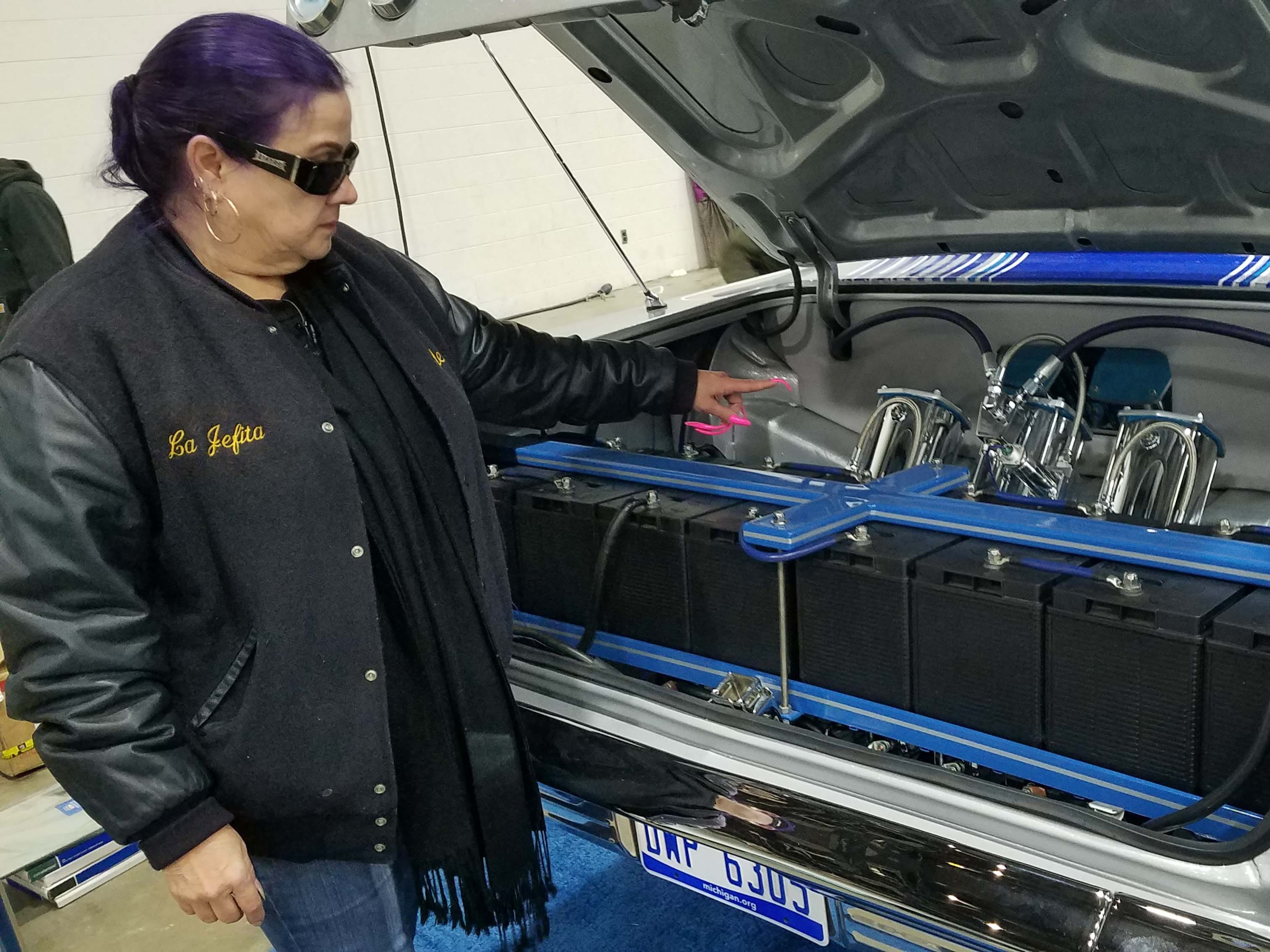 "Debbie ""The Queen of Lowriders"" Sanchez, Detroit, explains how low-riders use battey and hydraulic systems in the trunk to control the suspension."