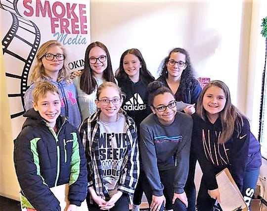 Reality Check teens bring their anti-tobacco message to the Corning Palace Theatre. Front row, from left, are Andrue Matthews, Amber Updike, Trinity Hammock and Gabby Makin. Back row, from left, are Sarah Joslyn, Savannah Ayers, Emma Pack and Trinity Ford.