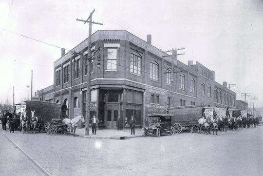 A look at the Geiger Moving and Storage Building at Northwest Second and Ingle streets in Downtown Evansville in the early 20th Century, with horses and buggies ready for action.