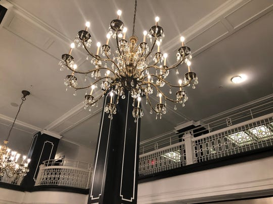 Guests will walk beneath chandeliers as they pass through the Hotel Retlaw's lobby.