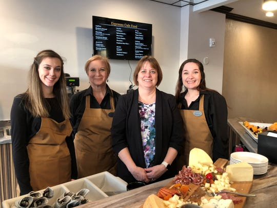 Hannah Neff, Kris Buchanan, Sara Cujak and Meghan Ryan smile inside the Hotel Retlaw's new  Espresso Café & Wine Bar which is located along Main Street.