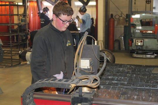 Zach Hasselbach, 16, of Gibsonburg, works on a plasma cutter at Vanguard Tech Center Thursday. The school has merged with Terra State Community College for a pathway partnership on  on eight programs.