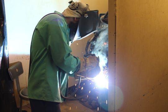 "Kyle Schaffer gets hands-on experience in Terra State Community College's welding lab Thursday night in Jeremy ""Huey"" Ley's class. Schaffer is enrolled at Terra State as part of an apprenticeship with Ventra in Sandusky. The college is looking to continue boosting its manufacturing and skilled trades programs and maintain strong relationships with area businesses."
