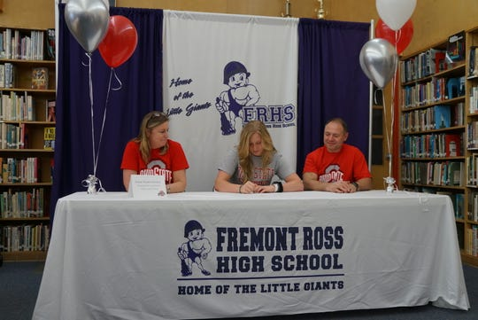Fremont Ross senior AnneMarie Moses continues her pole vault career at Ohio State. She's joined by mother, Tina, and father, Jerry.