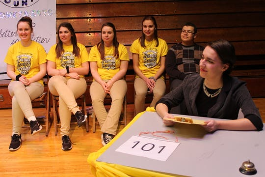 """St. Joseph Central Catholic High School students Maddie Molyet, seated right, and, from left to right, Kaylyn Klos, Cami Caudill, Hannah Haubert, Natalie Cook and Aiden Steinmetz, will be performing in the school's spring musical """"The 25th Annual Putnam County Spelling Bee"""" March 8 and 9 at SJCC's performing arts center."""