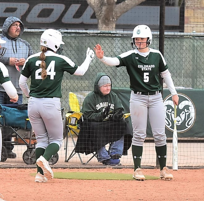CSU softball player Haley Donaldson (5) congratulates teammate Isabella Navarro after Navarro scored a run in a Feb. 28 win over Idaho State at Ram Field. The Rams (20-4, 3-0 Mountain West) were ranked No. 25 Wednesday in the latest Softball America Top 25 poll.