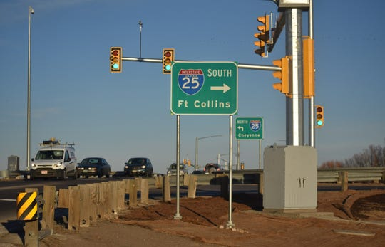 Vehicles drive west Monday on Colorado Highway 1 over Interstate 25 in Wellington, where the traffic light shown was recently installed.
