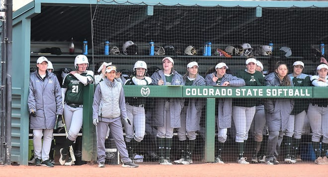 Coach Jen Fisher and players on the CSU softball team look on from the dugout during a Feb. 28 win over Idaho State at Ram Field. The Rams wrap up their first Mountain West home series of the season with a game at noon Sunday against Fresno State at Ram Field.