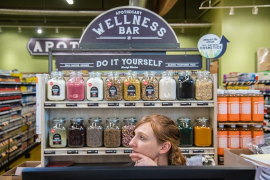 Lucky's Market Apothecary Manager Crystal Seago speaks with a fellow employee as she organizes the store's Apothecary Wellness Bar before the start of a celebration for team members on Friday, March 1, 2019, at 425 S. College Avenue, Fort Collins. Lucky's Market will hold a grand opening on Wednesday, March 6, 2019.