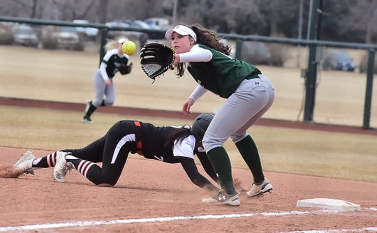 CSU first baseman Ashley Ruiz fields a throw back to the bag in an effort to catch an Idaho State base runner during a Feb. 28, 2019, game. The Rams, winners of 15 straight games, host Utah State in a weekend series beginning with a 4 p.m. game Friday at Ram Field.
