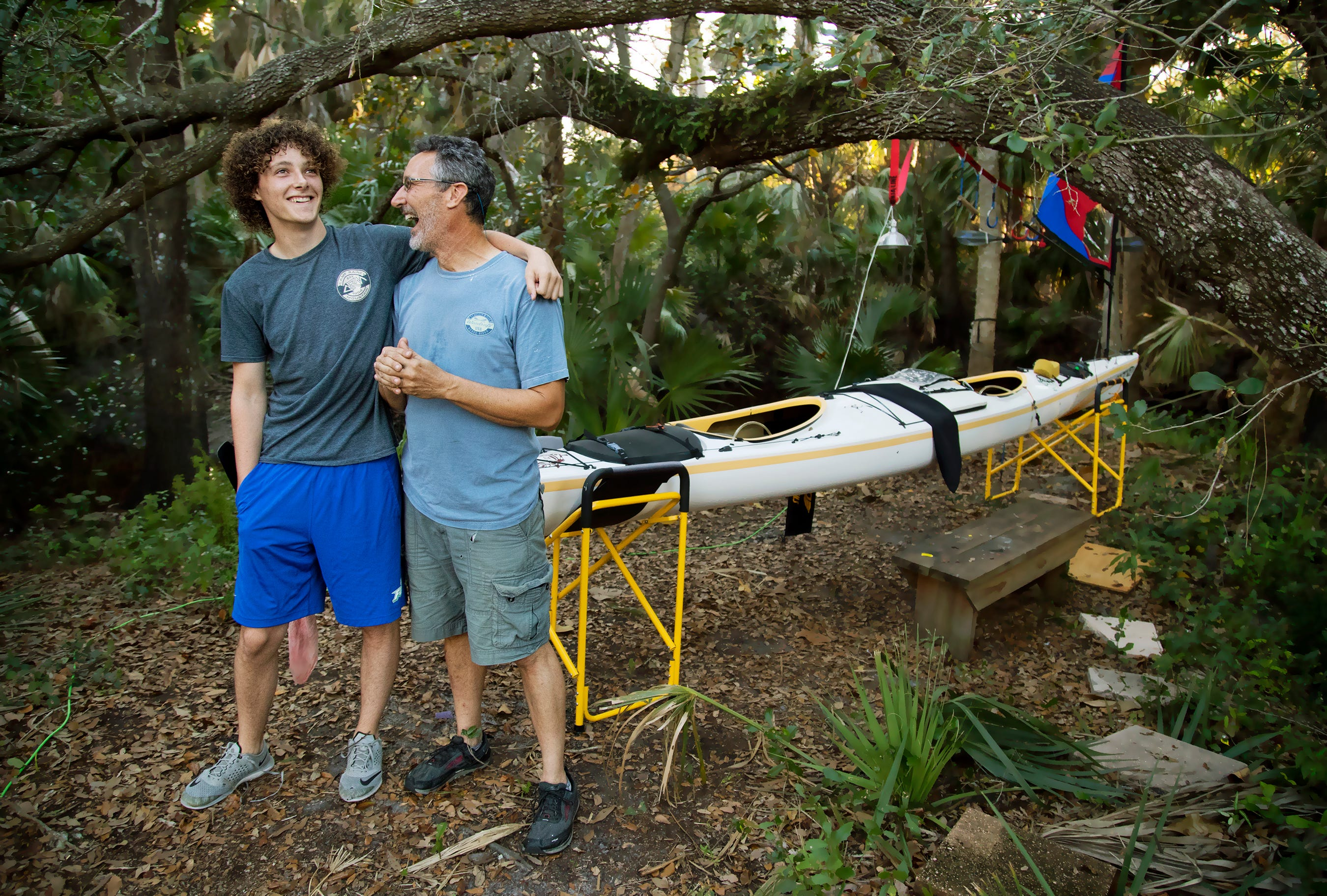 Maxfield Seixas, 19, and his father Mark Cecil at their Bonita Springs home on March 1. The following day they began a 300-mile kayak race but withdrew after learning that Maxfield's mother, Patricia Jean Sexias, died of cancer on March 3.