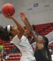 Fort Myers' Janay Outten goes up for a basket as Nease's Stephanie Manherz  tries to defend during the first half of their FHSAA Girls 7A semifinal game at The RP Funding Center in Lakeland Friday.