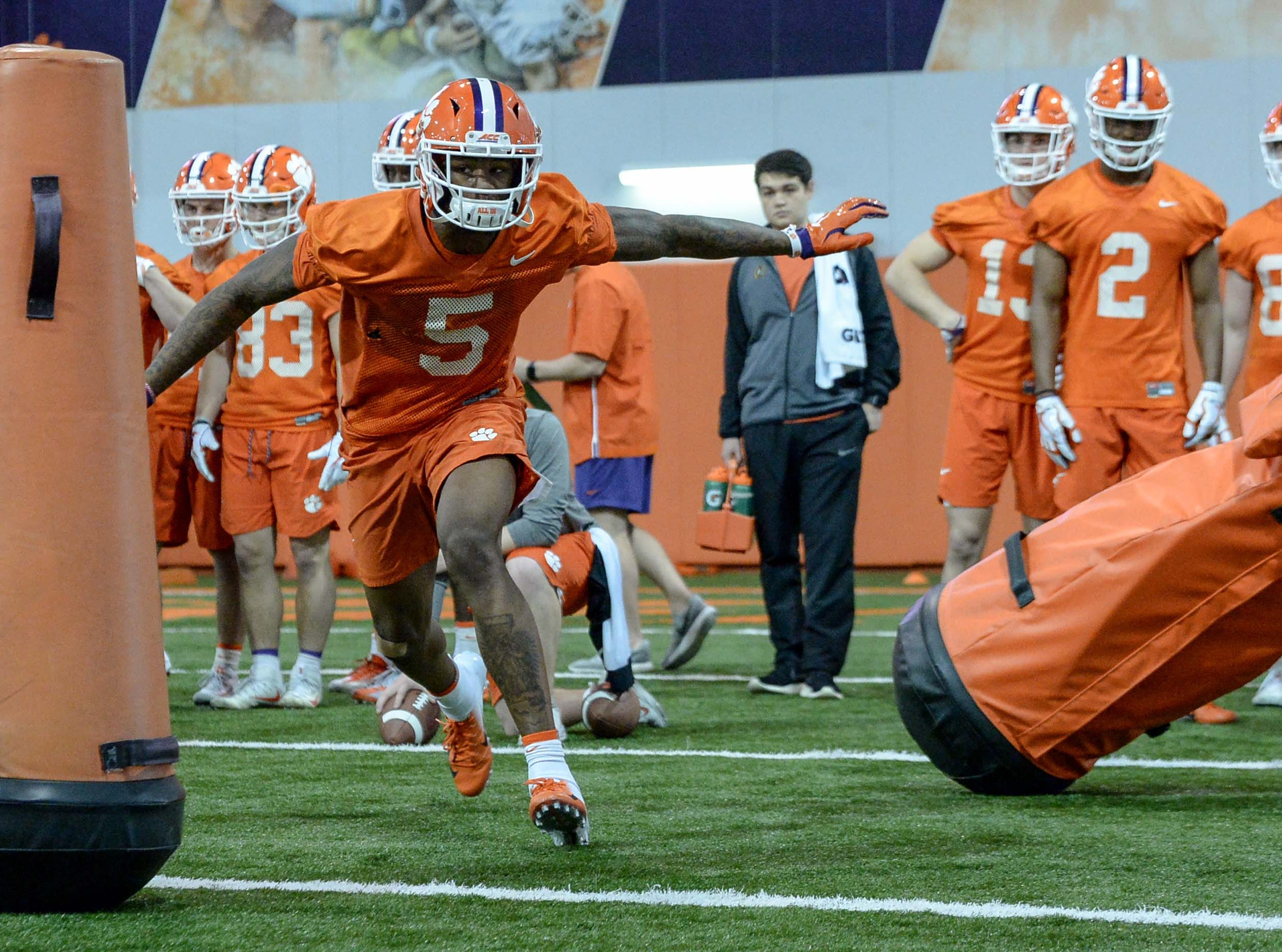 Clemson wide receiver Tee Higgins (5) runs in a drill during practice at the Poe Indoor Facility in Clemson Friday.