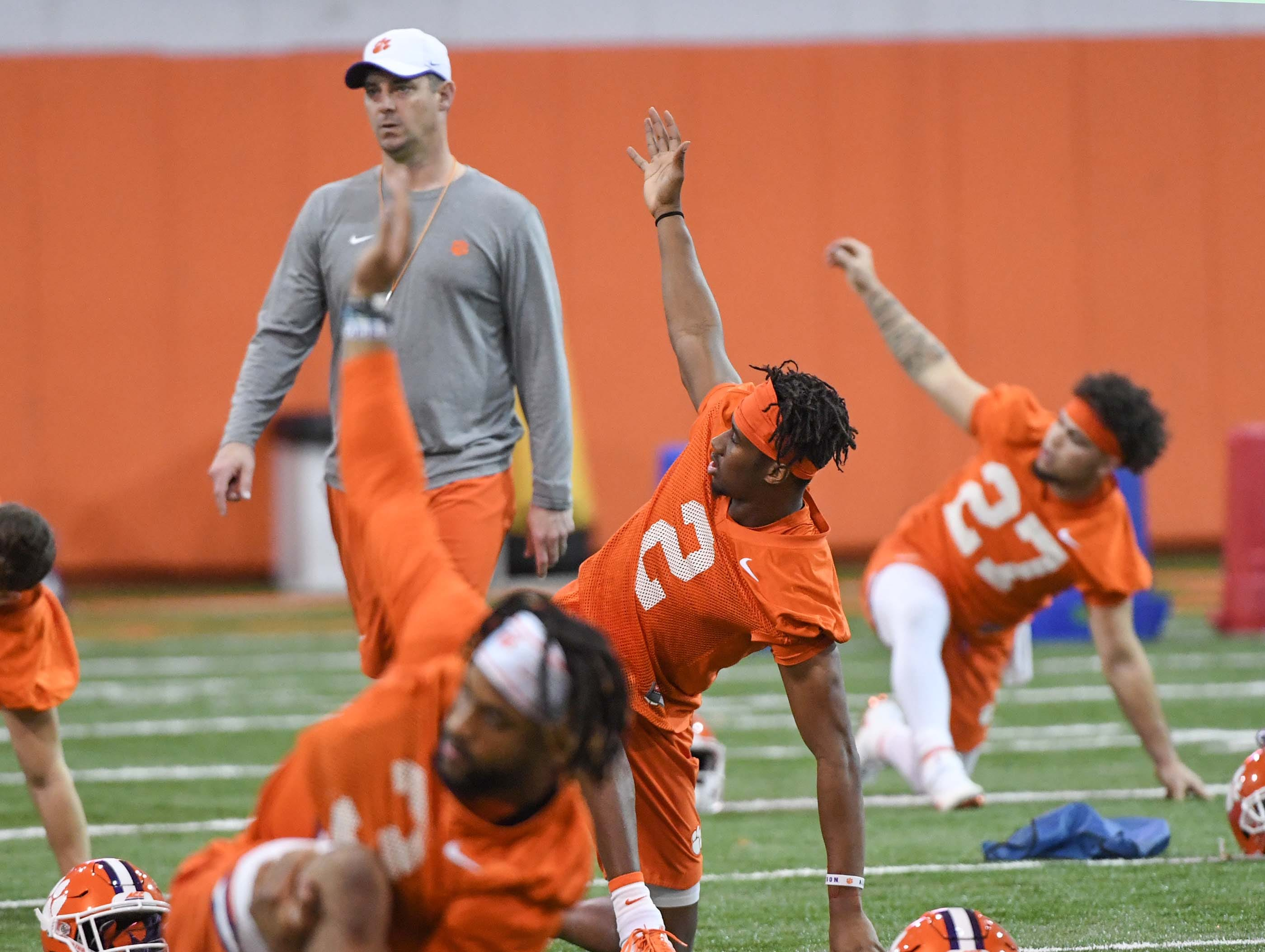 Clemson wide receiver Frank Ladson, Jr. (2) stretches during practice at the Poe Indoor Facility in Clemson Friday.