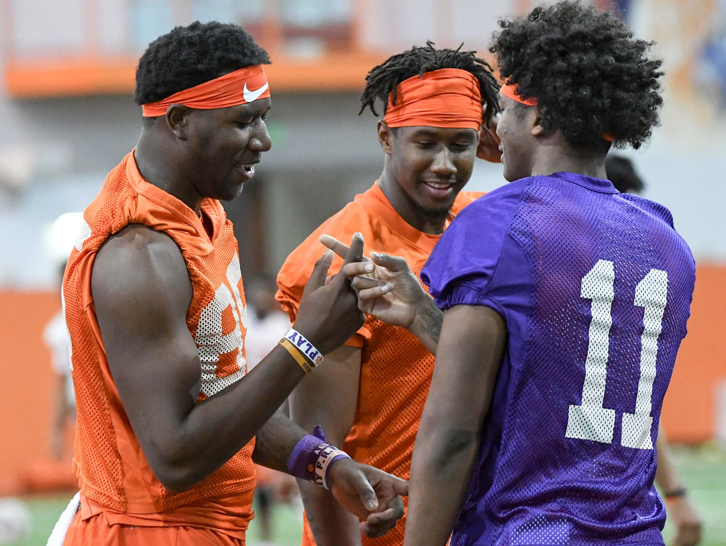 Clemson tight end Jaelyn Lay (85), left, wide receiver Frank Ladson, Jr. (2), and quarterback Taisun Phommachanh(11) greet each other before stretching during practice at the Poe Indoor Facility in Clemson Friday.