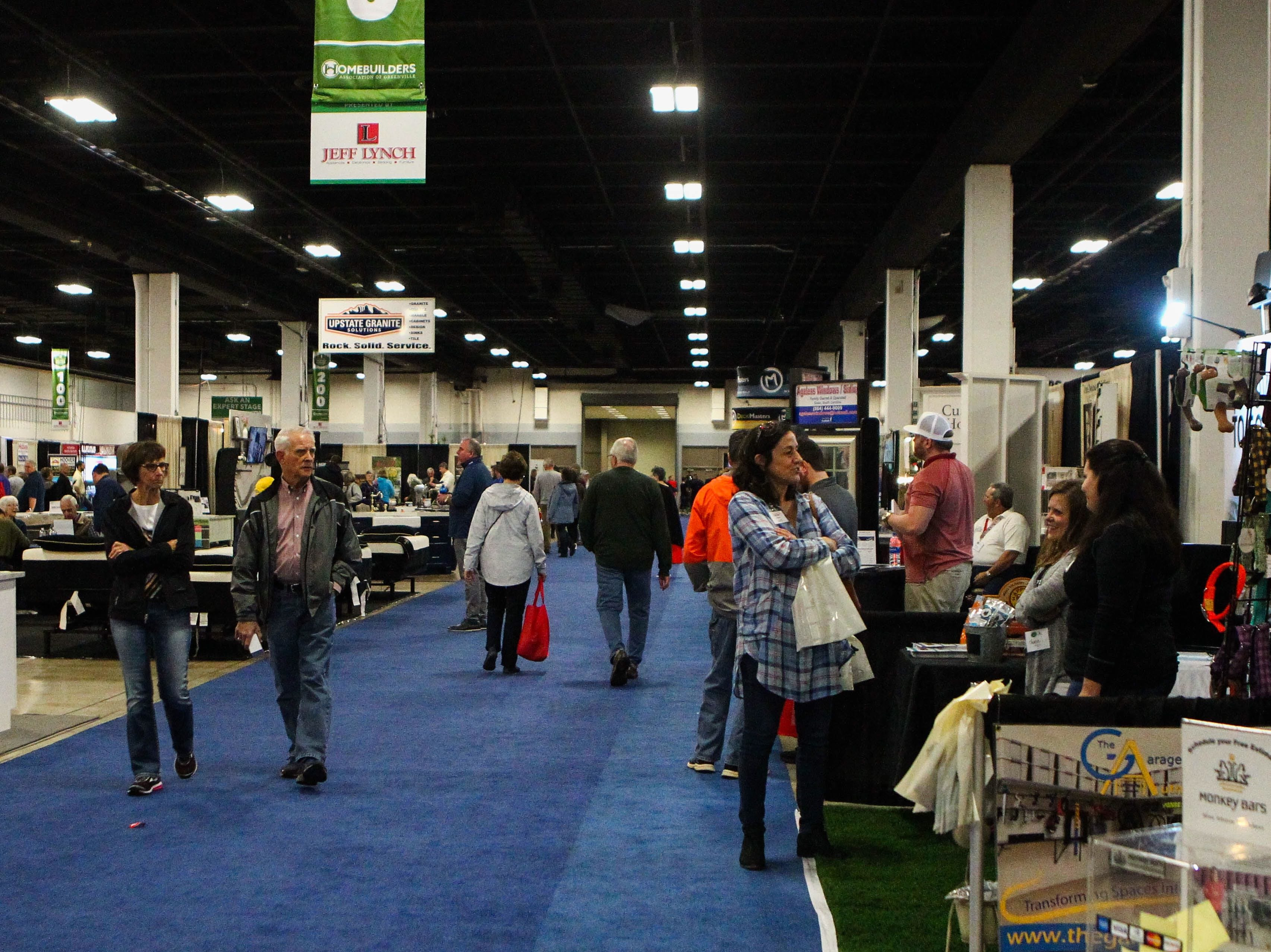 People stop by booths and businesses at the Southern Home and Garden Show at the Greenville Convention Center on Friday, March 1, 2019.