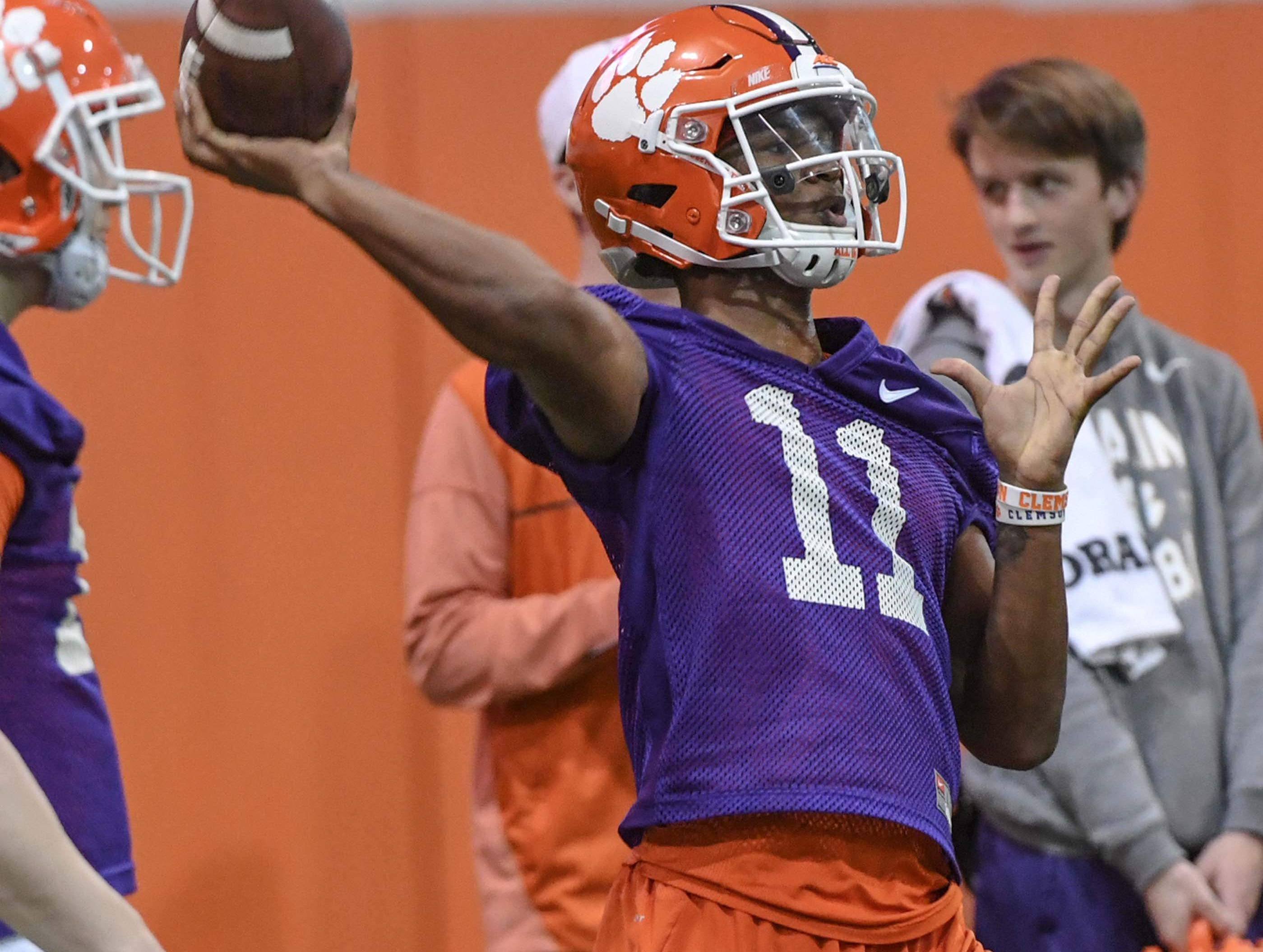 Clemson quarterback Taisun Phommachanh(11) throws a pass during practice at the Poe Indoor Facility in Clemson Friday.