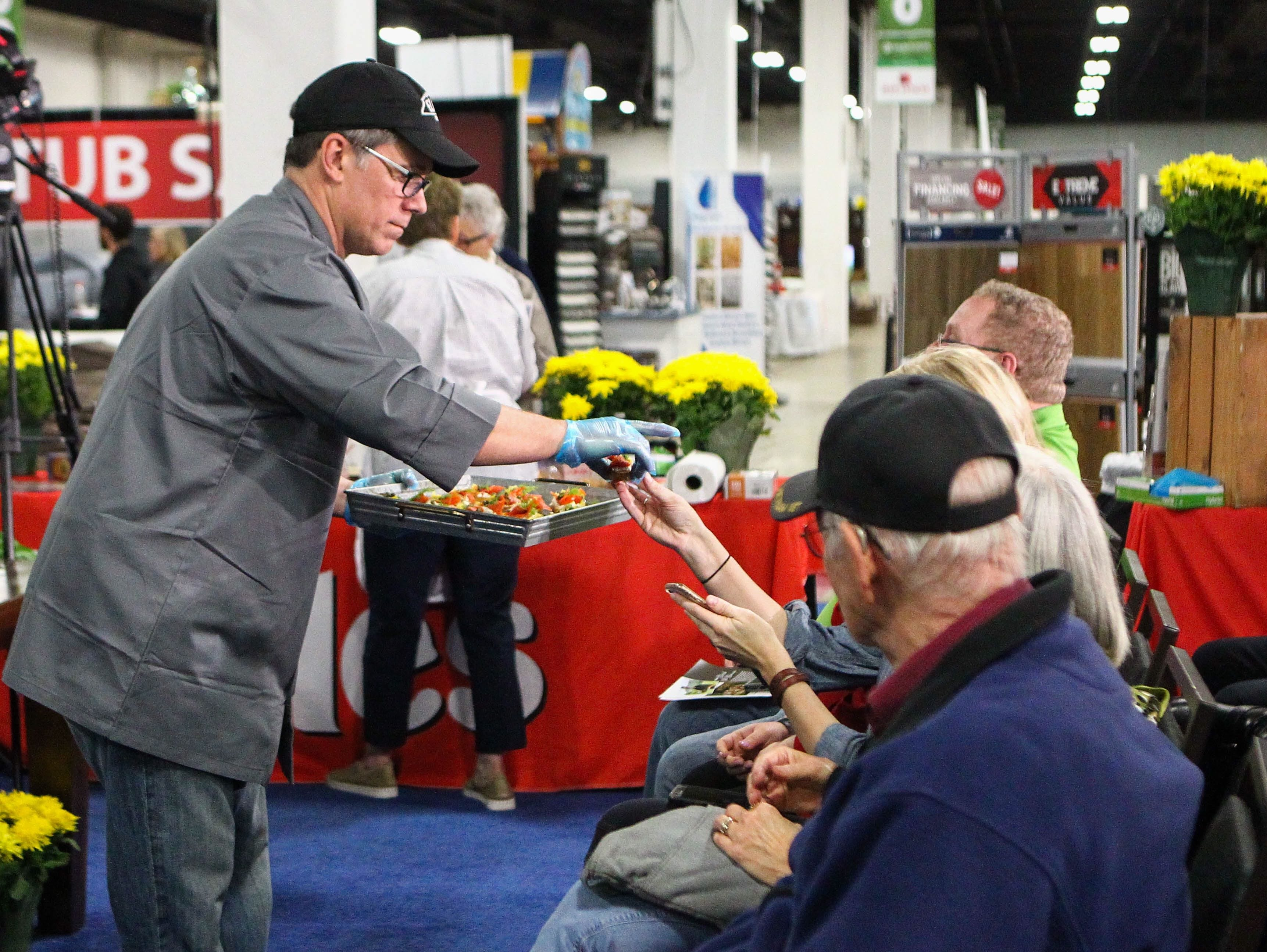 Chef Derek St. Romain hands out samples at the Southern Home and Garden Show at the Greenville Convention Center on Friday, March 1, 2019.