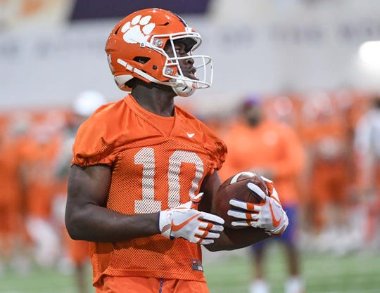 Clemson wide receiver Joseph Ngata (10) catches a ball during practice at the Poe Indoor Facility in Clemson Friday.