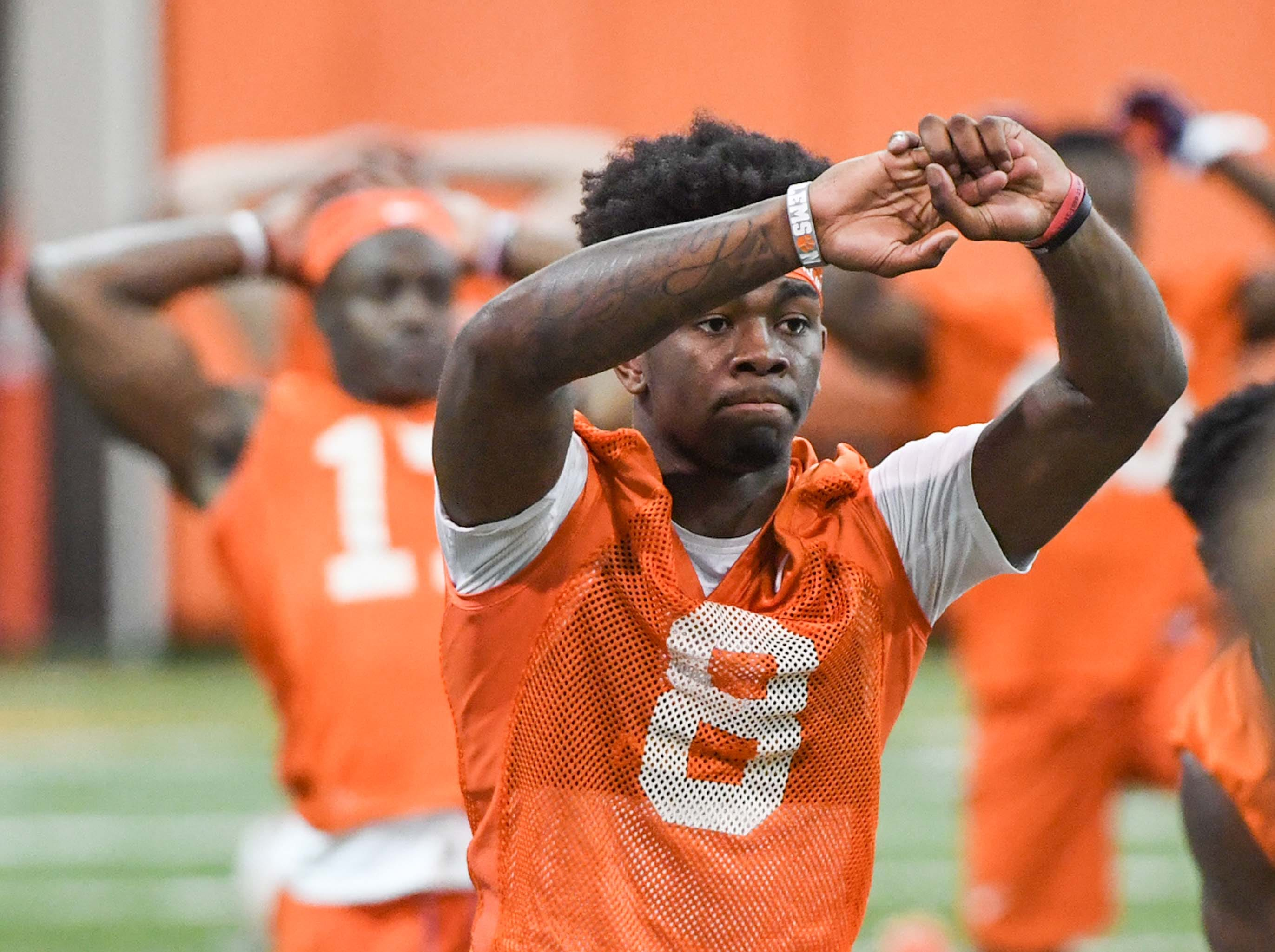 Clemson wide receiver Justyn Ross (8) stretches during practice at the Poe Indoor Facility in Clemson Friday.