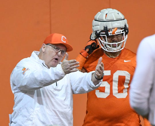 Clemson offensive line coach Robbie Caldwell, left, talks with Clemson offensive lineman Kaleb Boateng(50) during practice at the Poe Indoor Facility in Clemson Friday.