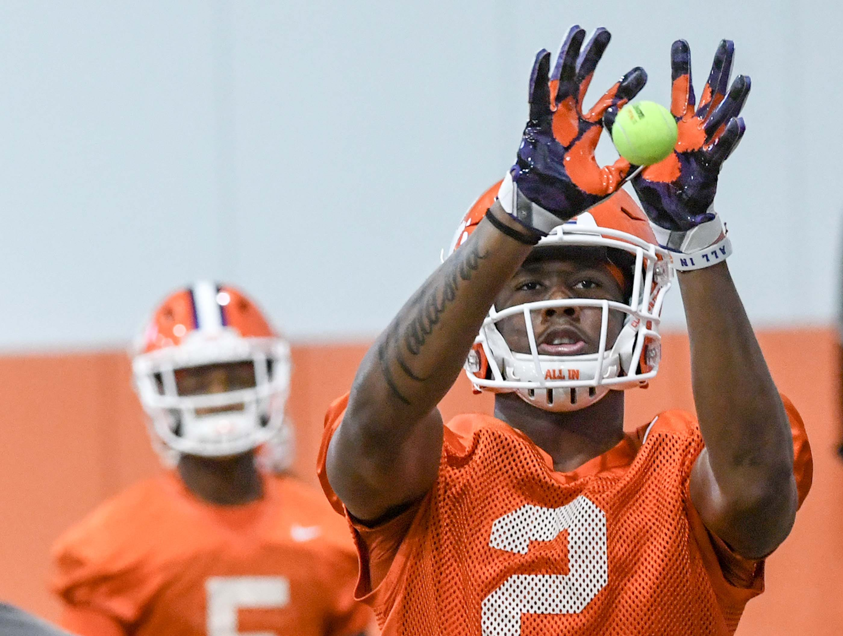 Clemson wide receiver Frank Ladson, Jr. (2) catches a tennis ball in a drill during practice at the Poe Indoor Facility in Clemson Friday.