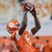 Clemson wide receiver Justyn Ross (8) catches a ball during practice at the Poe Indoor Facility in Clemson Friday.