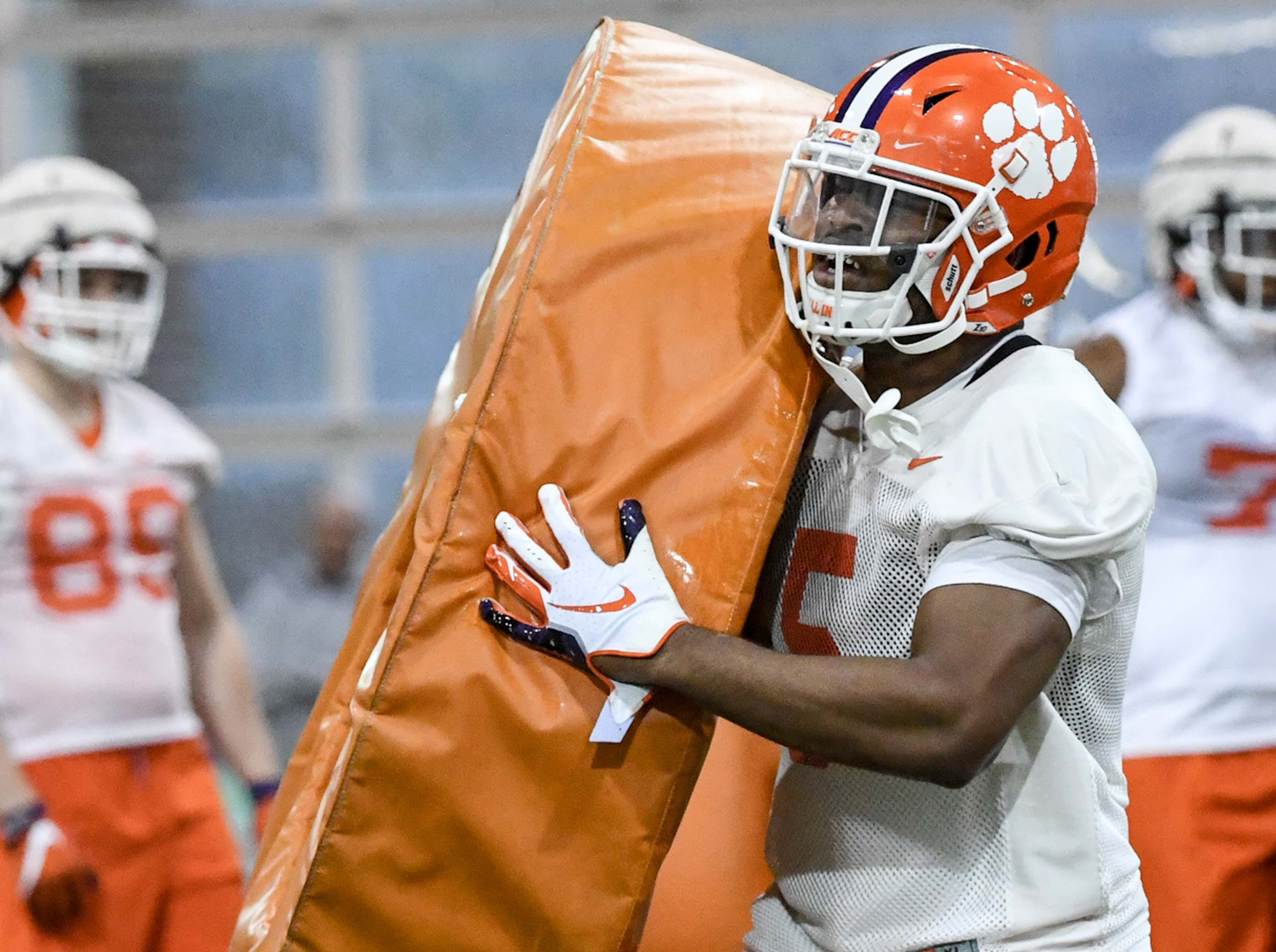 Clemson linebacker Shaq Smith (5) hits a pad during practice at the Poe Indoor Facility in Clemson Friday.