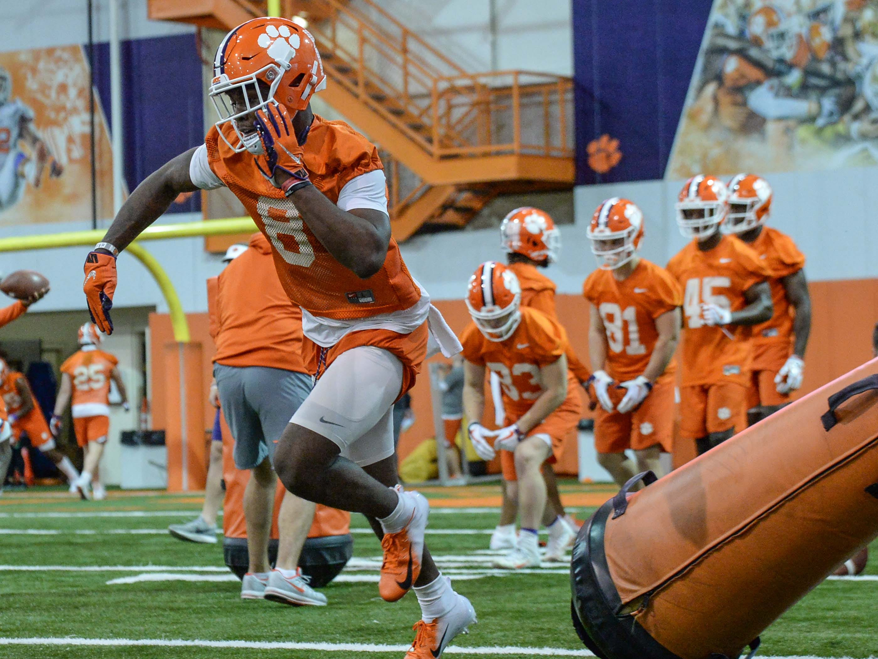 Clemson wide receiver Justyn Ross (8) runs in a drill during practice at the Poe Indoor Facility in Clemson Friday.