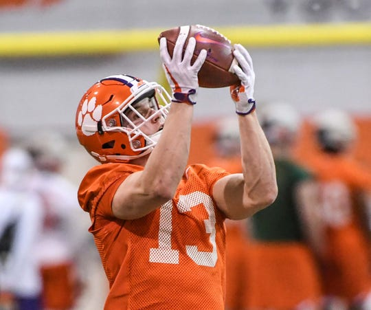 Clemson wide receiver Brannon Spector(13) catches a ball during practice at the Poe Indoor Facility in Clemson Friday.