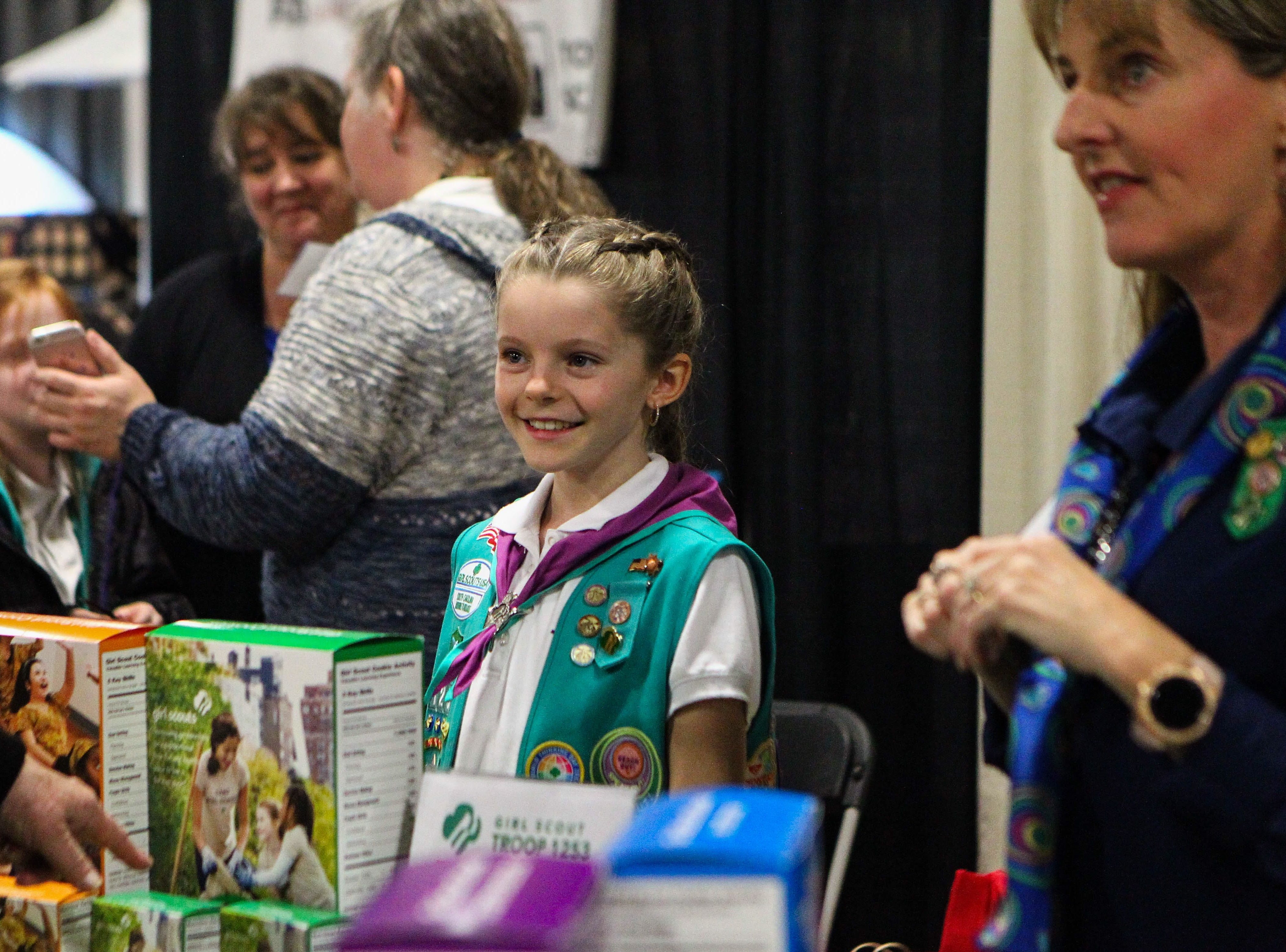 Kelli Kivett, 10, sells girl scout cookies with her mom Dee Kivettat the Southern Home and Garden Show at the Greenville Convention Center on Friday, March 1, 2019. Kelli is part of The Girl Scout Troop 1253.