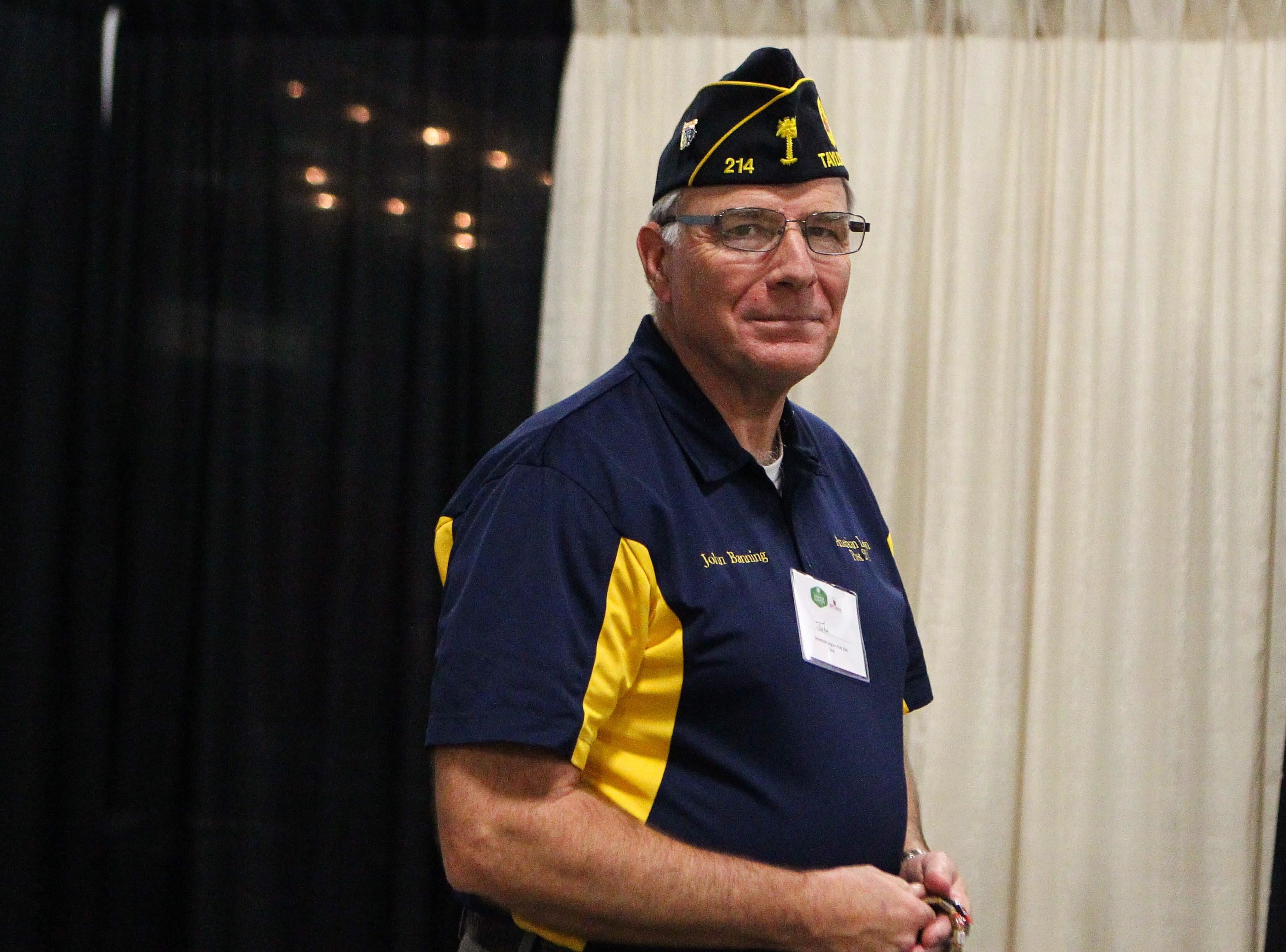 Veteran John Banning poses at his booth at the Southern Home and Garden Show at the Greenville Convention Center on Friday, March 1, 2019.