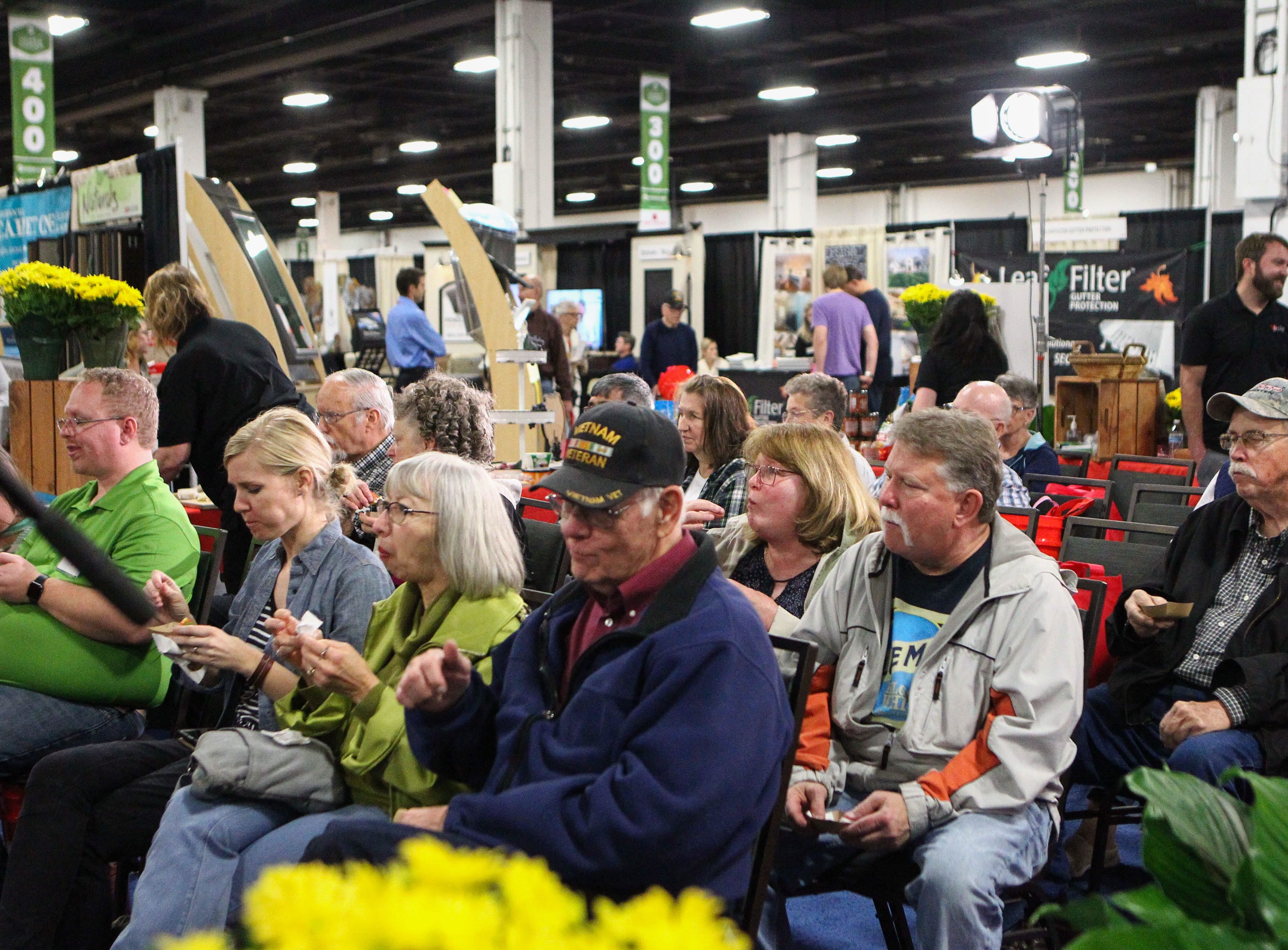 People watch the cooking demonstrations and enjoy samples at the Southern Home and Garden Show at the Greenville Convention Center on Friday, March 1, 2019.