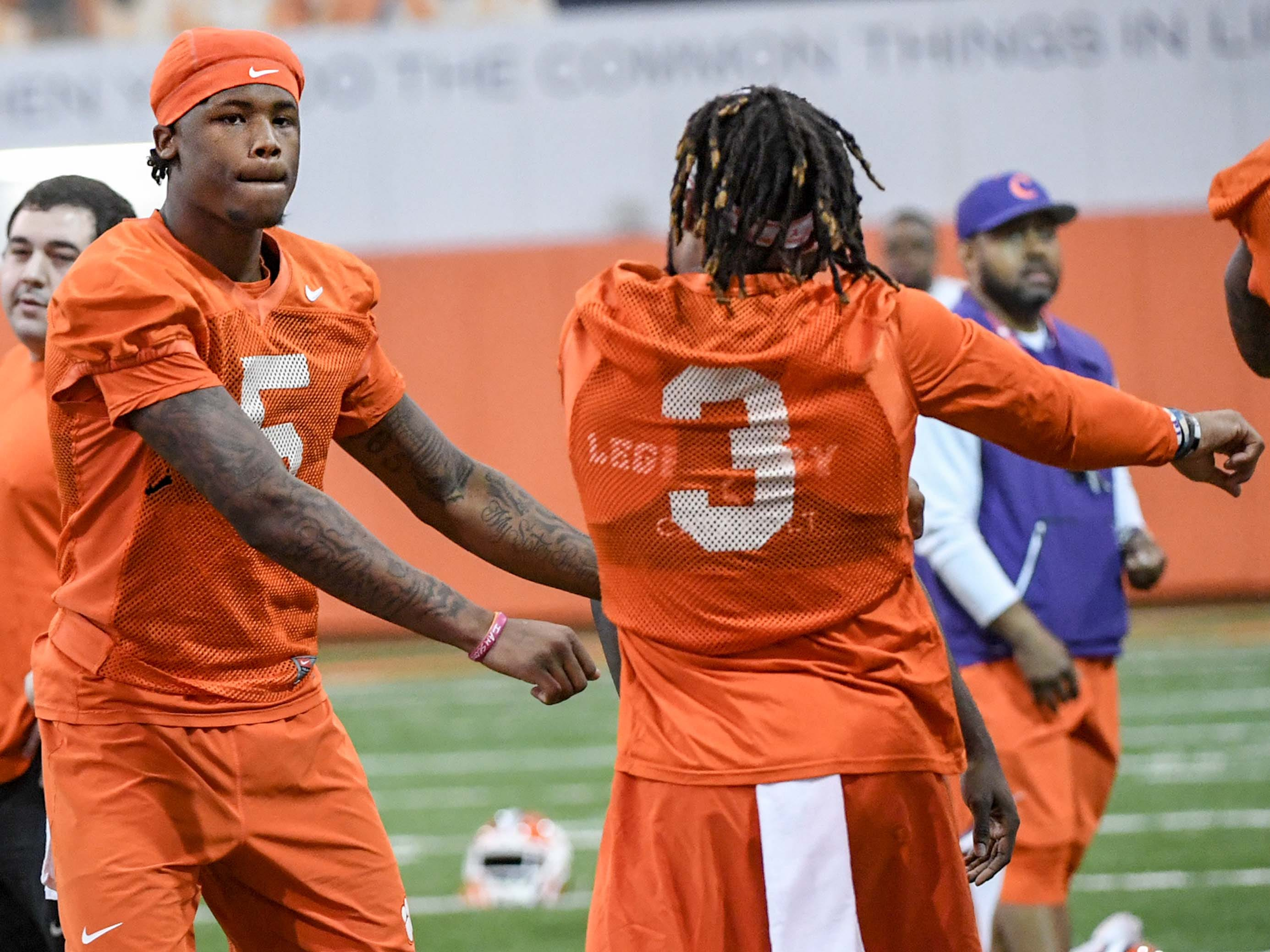 Clemson wide receiver Tee Higgins (5), left, and Clemson wide receiver Amari Rodgers (3) greet each other during practice at the Poe Indoor Facility in Clemson Friday.