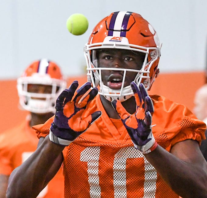 Clemson wide receiver Joseph Ngata (10) catches a tennis ball in a drill during practice at the Poe Indoor Facility in Clemson Friday.