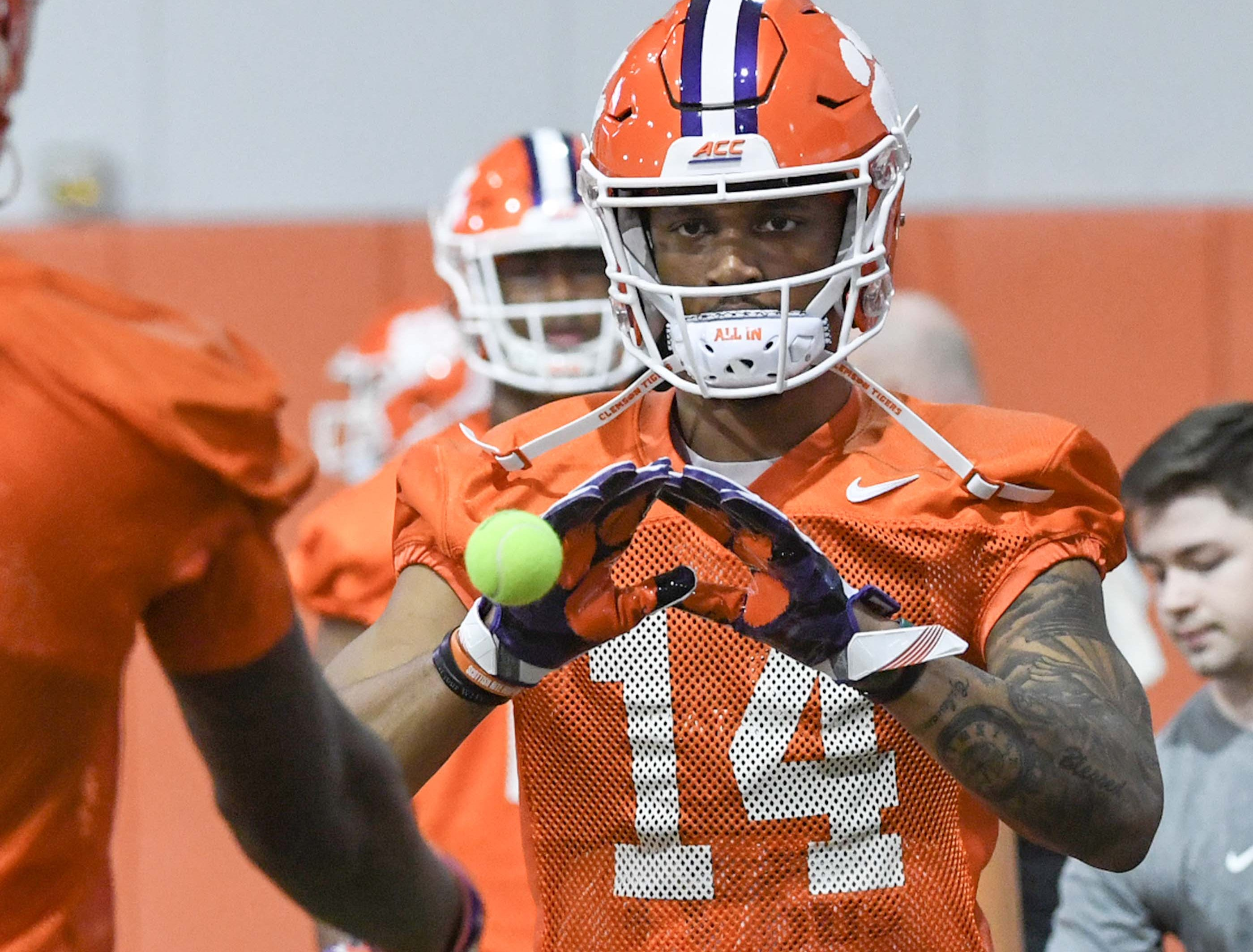 Clemson wide receiver Diondre Overton (14) catches a tennis ball in a drill during practice at the Poe Indoor Facility in Clemson Friday.