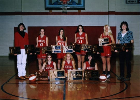 The Winifred Red Raiders won State C girls' basketball championships in 2003, 2005 and 2006. The '06 team included, back row from left, Mary Lou Stulc, Erin (Shammel) Baker, Amy (Meckling) McCarthy, Kari (Heggem) Underdal, Heather (Heggem) Prinkki, and coach Marietta Boyce. In front, from left, are Kamron (Fordyce) Edwards, Julie (Bergum) Ewen and Nicole Wickens.