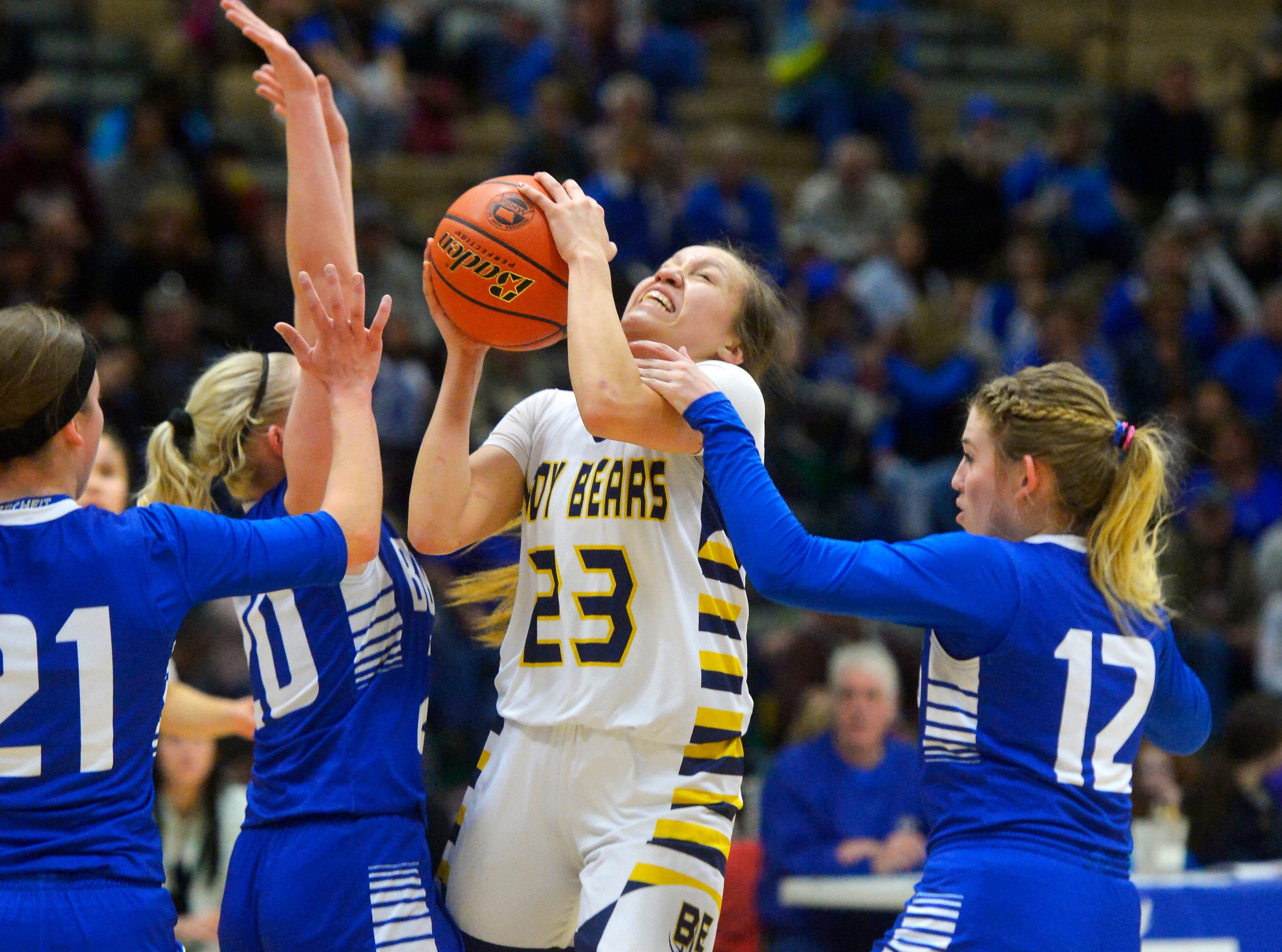 Box Elder's Kayla Momberg draws contact on her shot attempt in Thursday's game against Carter County during the Girls State C Basketball Tournament in the Four Seasons Arena.