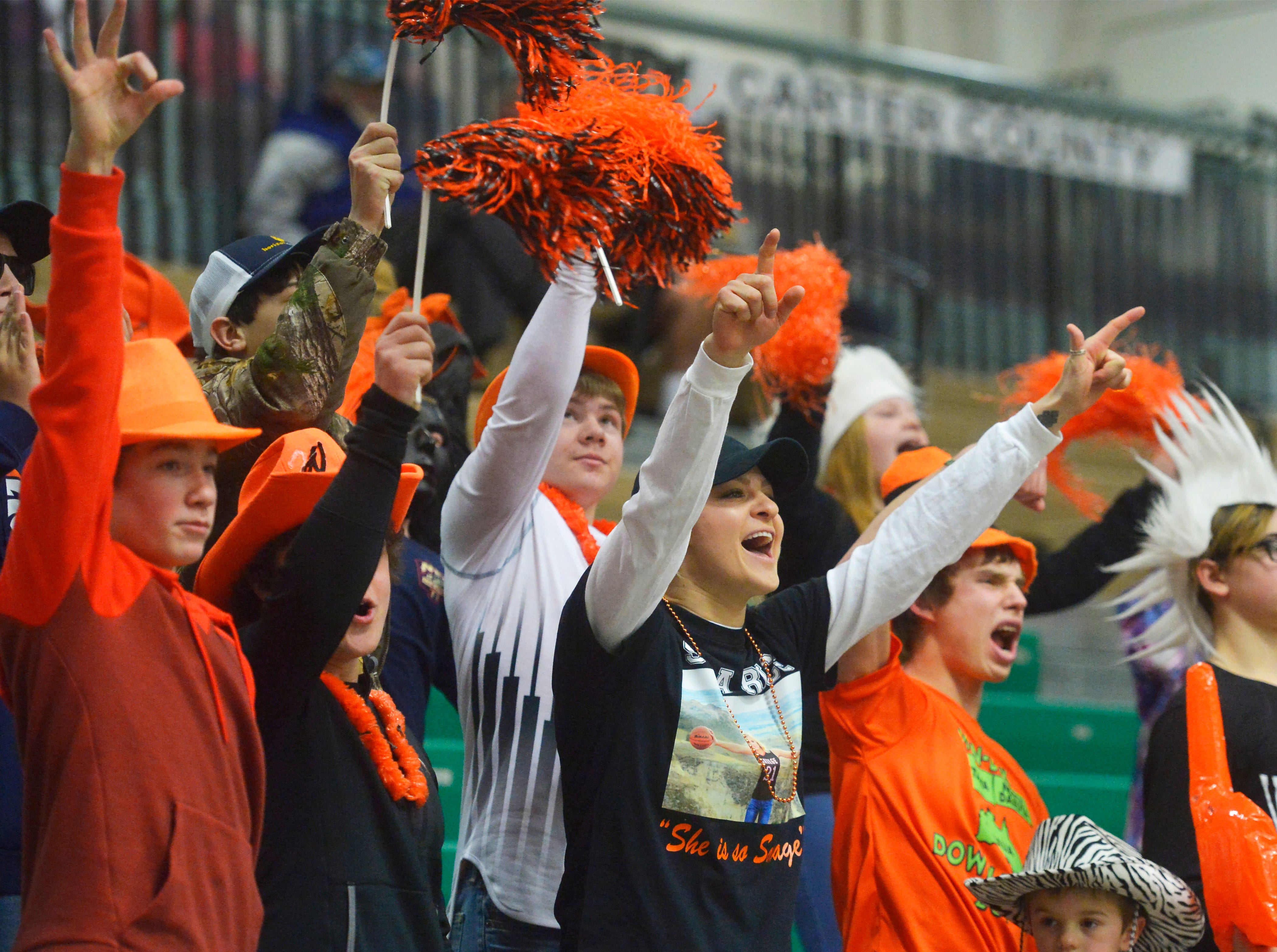 Savage cheering section during the Girls State C Basketball Tournament on Thursday in the Four Seasons Arena.