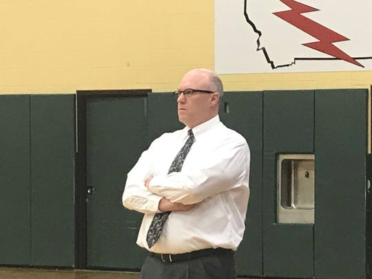 C.M. Russell head coach John Cislo surveys the action in the second half of the Rustlers-Billings Skyview opening round game at the Eastern AA Divisionals Thursday.