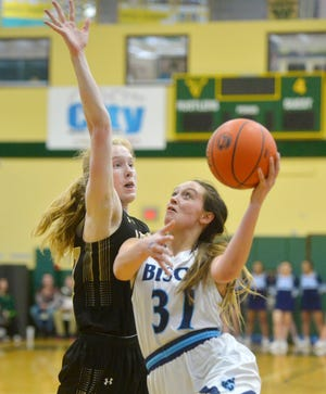 Great Falls High's Jorgie Hawthorne attempts a layup as Billings West's Maddie Albrecht defends during the semifinal game of the Eastern AA Basketball Tournament on Friday in the CMR Fieldhouse.